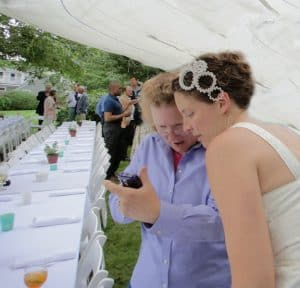 C.L. consulting with the bride